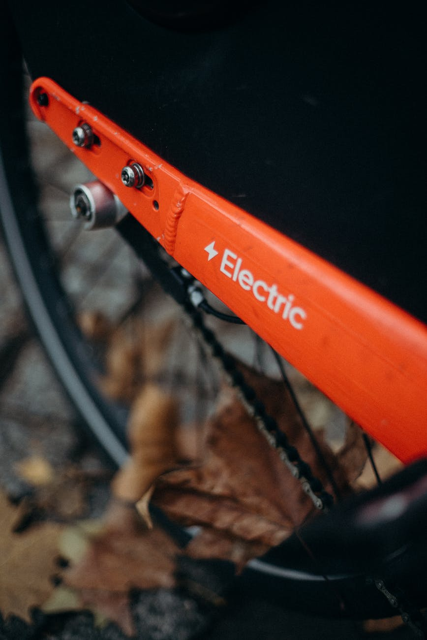 orange and black bicycle wheel